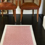 Red and cream patterned rug