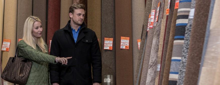 Couple choosing carpets